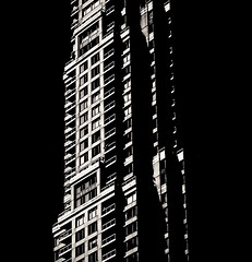 Sunny Side (Demmer S) Tags: building windows skyscraper tall tower highrise architecture architectural exterior design perspective shapes pattern abstract repetition repeating archidose geometric facade geometry lines urban outdoors onblack blackbackground linear balcony structure balconies outside sun light structural skyscrapers lookingup ny newyork nyc newyorkcity bw monochrome blackwhite blackandwhite blackwhitephotos blackwhitephoto window