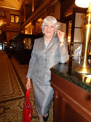 Business Woman Checking Into The Pfister Hotel (Laurette Victoria) Tags: woman businesswoman suit gray purse silver laurette lady laurettemcgovern hotel lobby milwaukee pfisterhotel