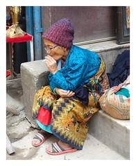 Taking a smoke break (posterboy2007) Tags: kathmandu nepal nepali woman oldwoman smoking street color cigarette sony sonyrx100m3