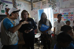 Penny Mordaunt meets UNICEF aid workers helping Rohingya refugee children at a UK-supported learning centre in the Kutapalong camp near Cox's Bazar in Bangladesh