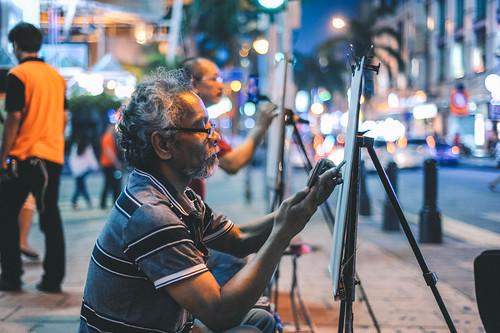 pelukis jalanan di bukit bintang