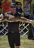 It's A Stretch (Scott 97006) Tags: dog stretched show man guy performance cute trick stunt