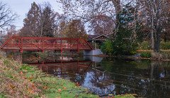 Autumn Trailing Away (tquist24) Tags: goshen indiana nikon nikond5300 autumn bridge fall geotagged leaves longexposure reflection reflections river tree trees water unitedstates