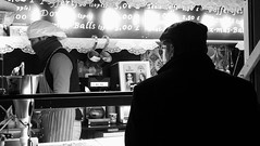 festive market at night 06 (byronv2) Tags: festive festivemarket christmasmarket peoplewatching candid street princesstreet princesstreetgardens edinburgh edimbourg edinburghbynight night nuit nacht blackandwhite blackwhite bw monochrome market mound