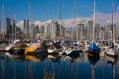 Views from the Seawall of Vancouver (beyondhue) Tags: seawall boats vancouver mountains reflection beyondhue bc vanada sunny building downtown view horizon skyline sea wall scenery marina rockies sailboat sail calm