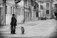 Strange dialog (Roberto Marzola) Tags: dialogue interaction animal behaviorhumanandanimal dog woman blackandwhite streetphotography robertomarzola