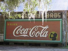 Coca-Cola raised on cinder blocks (jimsawthat) Tags: smalltown micanopy florida coke cocacola ghostsign repainted vintagesign spanishmoss