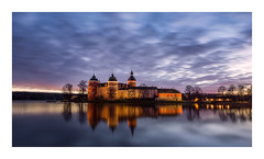 Gripsholms slott (Andreas Larzon Photography) Tags: house andreaslarzon backlight backlit building calmwater castle cloudy coast dusk facadelighting glasswater gripsholm intermediatelandscape landscape landscapephotography longexposure lowclouds mariefred mirrorwater nikond7200 ocean reflections sea seascape serene shoreline sigma1020mmf35exdchsm smoothwater sunset sweden twilight wamlight water atmospheric seaside
