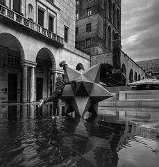 City Frames (enrikobe) Tags: white black bn travels viaggi games child reflections water vittoria piazza italy brescia