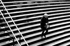 On the wet steps (pascalcolin1) Tags: paris13 femme woman marches steps pluie rain humide wet rampe reflets reflection photoderue streetview urbanarte noiretblanc blackandwhite photopascalcolin 5omm canon50mm canon