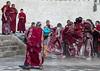Tibetan monks enjoying a water fight after the yearly renovation of the Rongwo monastery, Tongren County, Longwu, China (Eric Lafforgue) Tags: amdo asia asian bucket buddhism buddhist china china17268 colourimage cultures fighting fulllenght fun groupofpeople horizontal huangnan humaninterest joy lime longwu men monastery monk monks outdoors qinghaiprovince red ronggonchen rongpo rongwo splashing teenageboys tibet tibetan tibetanautonomousprefecture tibetanethnicity touristdestination traditionalclothing waterfight wet youngadults tongrencounty chn