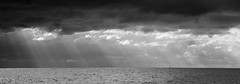 The lonely sea and the sky (OzzRod) Tags: pentax k1 hdpentaxdfa150450mmf4556 monochrome blackandwhite sky clouds ocean sea dark rays crepuscular yacht boat stitch panorama