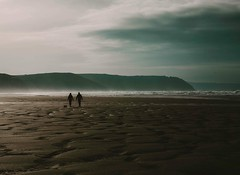 a walk on the beach ... (Jess Feldon) Tags: lookslikefilm sand jessfeldon waves sea surf walkers perranporth cornwall beach coast