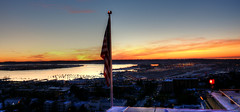 Standing On The Edge - San Diego Intl Airport (Spebak) Tags: spebak canon canondslr canon70d flag usflag california southerncalifornia socal roof rooftop airport sandiego sandiegobay bay water sunset harbor evening