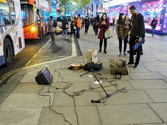 20171124T17-31-14Z-_B247390 (fitzrovialitter) Tags: masshysteria terrorismscare westend oxfordstreet oxfordcircus friday november24 afternoon panic police shops blackfriday crowds stampede peterfoster fitzrovialitter flytipping urban street environment london streetphotography documentary authenticstreet reportage photojournalism editorial captureone littergram exiftool olympusem1markii voigtländer175mmf095 cosina nokton microphone speaker micstand pavement abandoned guitar bus