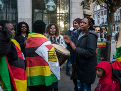 Zimbabwe Vigil (Silver Machine) Tags: london streetphotography street candid candideyecontact protest humanrights women drums singing flag zimbabwe zimbabwevigil lumix lumixg lumixg5 lumixg20mmf17