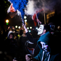 Three Colors (Sean Batten) Tags: london england uk streetphotography street people mask vforvendetta protest protester city urban nikon df 58mm smoke red white blue millionmaskmarch trafalgarsquare