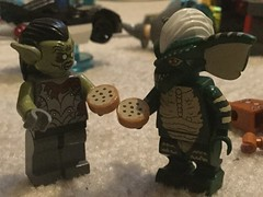 Making Cookies Out of Gingerbread (splinky9000) Tags: lego minifigures toys gingerbread man death lord of the rings hobbit moria orc goblin gremlins stripe gremlin eating snacking devouring cookies chocolate chip kingston ontario