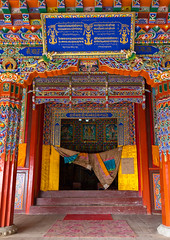 Doorway of the temple in Shachong monastery, Qinghai Province, Wayaotai, China (Eric Lafforgue) Tags: amdo antique architecturaldetail architecture asia buddhism china china17039 colourimage cultural cultures decoration door doorknob doorway entrance entryway gelug heritage huangnan monastery nopeople ornate portal prayerflag qinghaiprovince red scarf shachong tibetan tibetanautonomousprefecture tsongkhapa vertical wayaotai worldtravel yellowhatsect chn