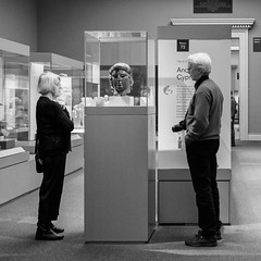 Appreciating Art 050 (Peter.Bartlett) Tags: square niksilverefex art unitedkingdom people city urbanarte woman streetphotography peterbartlett lunaphoto man urban noiretblanc candid uk m43 microfourthirds camera bw olympusomdem5 sign blackandwhite couple monochrome london england gb britishmuseum gallery