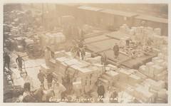 German prisoners unloading (hoosiermarine) Tags: german prisoner prisoners supplies railway depot wwi worldwar1 worldwarone ww1 worldwari weltkrieg supply boxcar boxcars railroad
