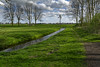 On The Road (Alfred Grupstra) Tags: nature tree grass landscape outdoors greencolor sky ruralscene netherlands footpath scenics summer springtime water blue field meadow nopeople windmill