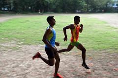 Surging ahead (sanat_das) Tags: kolkata rabindrasarobar athletes training sprinting 50mm d800 surgingahead field