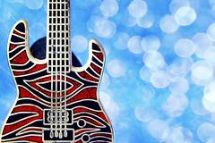 fiesta time (maotaola) Tags: macromondays musicalinstruments redandblue pin perfectcomposition guitar guitarraeléctrica colours fiestatime miniguitar lightsandmusic miniature miniatura musicalinstrument catchycolor bluebokeh turquoise