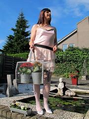 Bag of flowers (Paula Satijn) Tags: sexy hot girl tgirl tranny transvestite skirt miniskirt legs stockings pink white smile happy joy fun satin silk shiny heels pumps garden flowers sunshine playful cheerful sensual