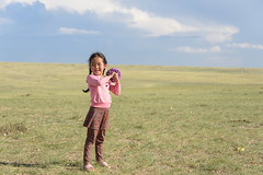 Mongolia - Little Girl Playing Baseball (GlobeTrotter 2000) Tags: asia baseball children girl local mongolia tourism travel visit portrait yurt tent