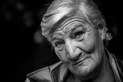 The old lady with the rough voice (AlphaAndi) Tags: mono monochrome urban trier tiefenschärfe people portrait leute menschen menschenbilder city closeup nahaufnahme gesicht face fullframe vollformat dof homeless heimatlos obdachlos
