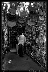 Entre bolsos y babuchas (meggiecaminos) Tags: marruecos morocco marocco maroc asilah bolsos babuchas zapatos bailarinas sandalias hombre mujer uomo donna woman man gente people shoes scarpe bags piel leather bw bn bianco blanco black negro nero white streetphotography shop zapatería tienda shoeshop tendero vendedor urbanphotography paisajeurbano negoziodiscarpe negozio pantofola slipper flipsflops sandals sandali pelle borse