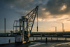 Another day, another dollar. (A.Dissing) Tags: the sun was setting down harbour beautiful old crane dark yellow work worn end days horsens a7ii anders a7 amazing art animal awesome adventure a7m2 angle artistic denmark dissing danmark dead day dirty sunset scape