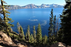Swirl (Jane Inman Stormer) Tags: lake trees pines mountain craterlakenationalpark blue pollen swirl current peak landscape oregon hill water spiral snow forest tree