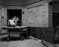 Selves Dissolving (sadandbeautiful (Sarah)) Tags: me woman female self selfportrait abandoned bw hospital gurney