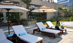 Relaxing By The Pool (Harold Brown) Tags: architecture bhaga browngeeta building hitechcity hotel hyderabad india mindspace outdoor pool telangana travel water westin westinhotel westinhotelmindspace westinhyderabad bhagavideocom haroldbrowncom harolddashbrowncom photosbhagavideocom haroldbrown