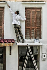 Stretch (Cirrusgazer) Tags: crete rethymno decorating manatwork mirroring painting patterns reflecting reflection shapes streetphotography stretching tiptoes triangles