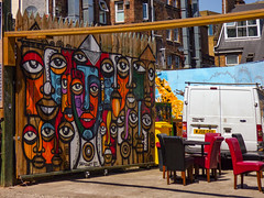 """No One's Here For Dinner"" (Steve Taylor (Photography)) Tags: art graffiti mural streetart cafe chair table tableandchairs colourful uk gb england greatbritain unitedkingdom london van e1 faces senzart senzart911 stanscafe"