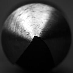 A lone cone in stone rhyming zone... (Kaarel Kaldre) Tags: macromondays stonerhymingzone koonus cone raud iron steel chamfer tool cut cutting sharp terav makro macro closeup mustvalge blackandwhite monochrome noiretblanc