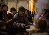 Castañero a tus castañas (Lara Santaella) Tags: streetphoto crowd nuts roast smoke night outdoors seller