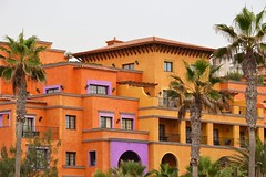 Orange (curly_em) Tags: building architecture orange purple palms palmtrees arch patterns loscristianos tenerife canaryislands