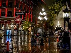 Photography - In spite of the rain (Christie : Colour & Light Collection) Tags: gastown historical history vancouver bc canada photog nightphotographer photographer cobblestone slick wet damp rain theworlds1ststeamclock steamclock building warehouse downtown city columbia waterstreet thegastownsteamclock canadianhistory nightphotography light lights nightlights stopsign clock timepiece reflections