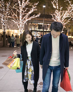 Young wife and husband walking together at night