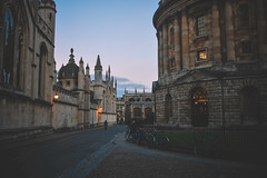 """""""There is only one day left, always starting over:  it is given to us at dawn and taken away from us at dusk.""""  Jean-Paul Sartre (Electra_star) Tags: oxford dusk city streetscape evening vscofilm vsco spires architecture"""