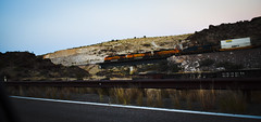 EB Passing a WB Creosote (Railroad Ties) train (Woodypug) Tags: mohave county kingman arizona bnsf us66 motherroad seligmansub sunset railroad route66