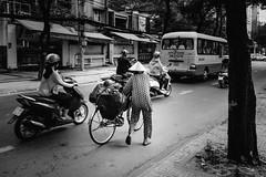 Walking through the traffic (Rico the noob) Tags: saigon street d500 person city outdoor vietnam urbanexploration 2017 monochrome travel published people bw blackandwhite urban 20mmf18 20mm