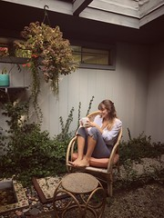 I love coffee (issabelschultz) Tags: relax sunday patio plants midcentury garden backyard trees iphone light warm summer girl home people portrait outside vintage coffee