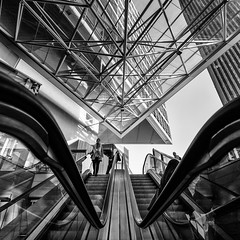 Escalators (laga2001) Tags: escalator vienna round curved lines architecture street streetphoto modern geometry contemporary monochrom black white bnw pov square