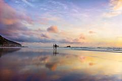 Maori Bay Sunset (lfeng1014) Tags: maoribaysunset maoribay sunset sunsetstroll surfers muriwai muriwaibeach aucklandregion northisland newzealand nz tasmansea ocean sea waves sky reflection canon5dmarkiii ef1635mmf28liiusm landscape travel blacksand blacksandbeach lifeng