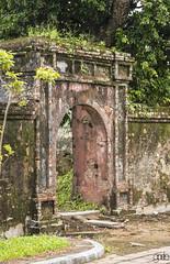 20171103_1256 (lgflickr1) Tags: vietnam hue citadel imperial arch old d750 nikon milvus zeiss weathered deteriorated worn bricks mortar southeastasia overcast clowdy wall doorway overgrown moss weeds